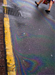 Motor oil leaked from individual vehicles -� or outright dumped by homeowners and commercial garages -� constitutes a significant chunk of storm water runoff, the fallen precipitation that runs off of roads and parking lots and inevitably finds its way into local water bodies. - Image by Kendrack, courtesy Flickr.""